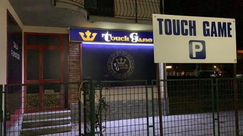 Negozio Touch game insegna vetrofania pannello